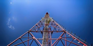 Enterprising business men warm hands on the panic with towers 5G