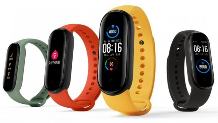 The fitness bracelet Xiaomi Mi Band 5: big screen, NFC and magnetic charger for $30